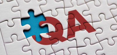 """A puzzle with the letters """"QA"""" in the middle, and one puzzle piece missing on the Q."""